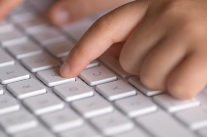 Child typing on keyboard